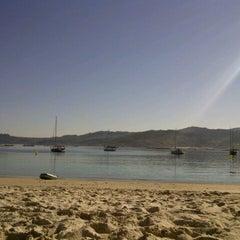 Photo taken at Praia de Castiñeiras by Sara L. on 7/17/2012