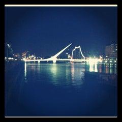 Photo taken at Puente de la Mujer by Dano C. on 3/8/2012