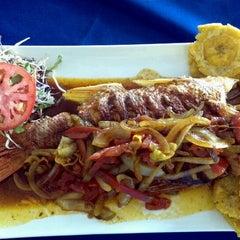 Photo taken at Guilligans Caribbean Food by Edgar Z. on 3/25/2012