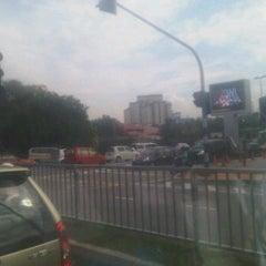 Photo taken at Traffic Light Gate UiTM Seksyen 7 by Awal S. on 2/13/2012