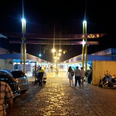 Photo taken at Feira Central by Richard M. on 8/5/2012