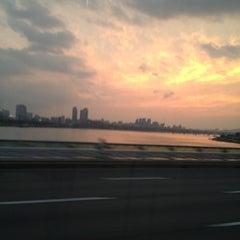 Photo taken at 잠실대교 (Jamsil Bridge) by Hyungmin P. on 9/9/2012