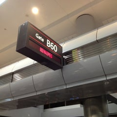 Photo taken at Gate B60 by Eric S. on 3/14/2012