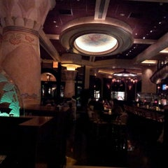 Photo taken at The Cheesecake Factory by Burak O. on 3/15/2012