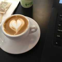 Photo taken at Press Coffee Roasters by Carlos A. on 7/18/2012