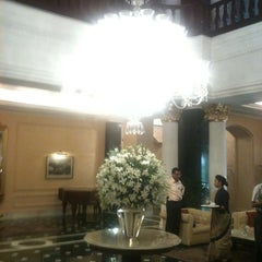Photo taken at The Oberoi Grand by Pritesh S. on 8/31/2012