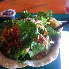 Photo taken at Cafe Rio Mexican Grill by Troy B. on 5/29/2012