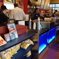 Photo taken at Café Zupas by Chelsi D. on 5/1/2012