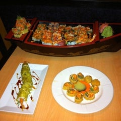Photo taken at Blue Pacific Sushi & Grill by Angel C. on 2/4/2012
