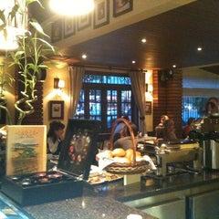 Photo taken at PaneOlio Ristorante & Caffe by Kenji S. on 5/30/2012