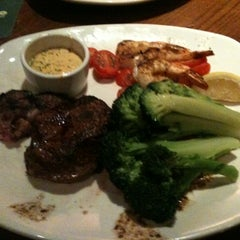 Photo taken at Outback Steakhouse by Joey C. on 2/27/2012