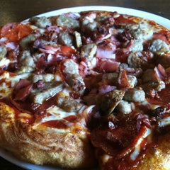 Photo taken at Rocky Mountain Pizza by Julian M. on 3/5/2012