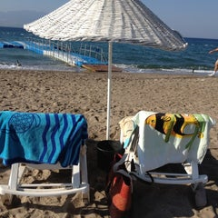Photo taken at Hayat Bana Güzel Beach by Elif on 9/5/2012