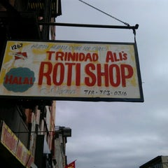 Photo taken at Ali's T & T Roti by RUTH H. on 7/28/2012