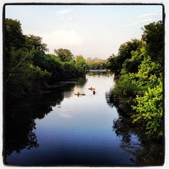 Photo taken at Barton Springs Pedestrian Bridge by Hooman on 7/4/2012