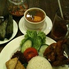 Photo taken at Kafe Betawi by Anastasia S. on 2/22/2012