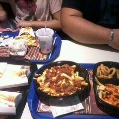 Photo taken at Burger King by Maria Luísa R. on 8/2/2012