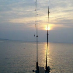 Photo taken at Sandy Point by Sarah T. on 6/23/2012