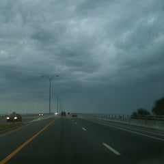 Photo taken at Dunlawton Bridge by Mary J. on 4/5/2012