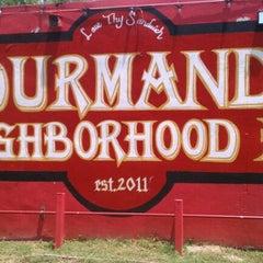 Photo taken at Gourmands Neighborhood Pub by Dana W. on 5/5/2012