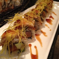 Photo taken at Ocean Blue Sushi Club by Danny on 5/21/2012