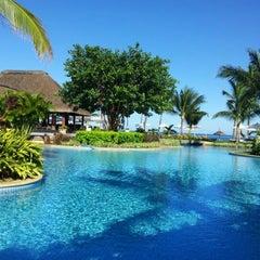Photo taken at Sugar Beach Mauritius Hotel Resort & Spa by Adi M. on 6/3/2012
