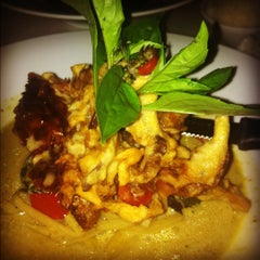 Photo taken at Osha Thai Kitchen by Aileen T. on 9/7/2012