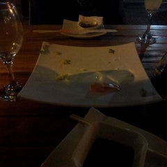 Photo taken at Ocho Sushi - Bar by Gustavo Adolfo F. on 2/19/2012