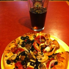 Photo taken at Woodstock's Pizza by Carlos C. on 8/5/2012