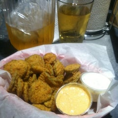 Photo taken at Dick's Wings & Grill by Ray M. on 7/7/2012