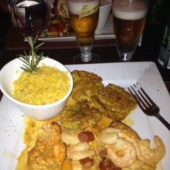 Photo taken at Mojitos Bar & Restaurant by Ruben C. on 7/3/2012