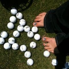 Photo taken at Mulligans Golf & Games by Lori D. on 6/14/2012