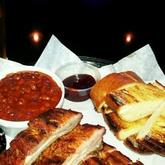 Photo taken at Dog House Grill by Nigel K. on 9/1/2012