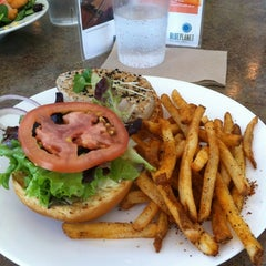 Photo taken at Blue Planet Natural Grill by Ian H. on 5/10/2012