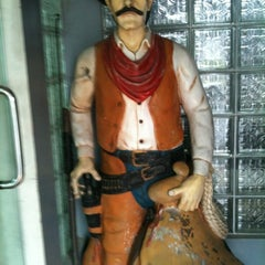 Photo taken at Cowboy Barber Shop by Timothy John D. on 9/2/2012