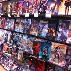Photo taken at Midtown Comics by Bruna F. on 6/14/2012