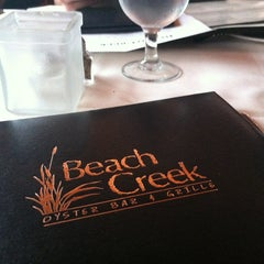 Photo taken at Beach Creek Oyster Bar & Grille by Kristen H. on 6/22/2012