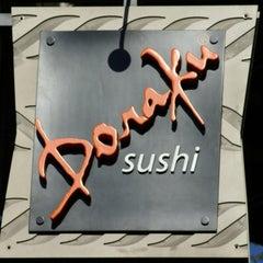 Photo taken at Doraku Sushi by Jennifer D. on 2/29/2012