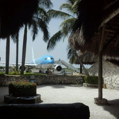 Photo taken at Punta Cana International Airport (PUJ) by Ivan Y. on 6/23/2012
