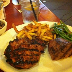 Photo taken at Tahoe Joe's Famous Steakhouse by Mike T. on 5/4/2012