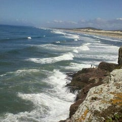 Photo taken at Praia da Guarita by izabella m. on 2/23/2012