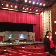 Photo taken at Gran Teatro del Cibao by Milciades N. on 3/4/2012