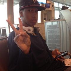 Photo taken at Gate 26 by Tiara D. on 6/22/2012