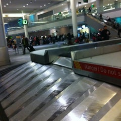 Photo taken at Baggage Claim by Kevin S. on 3/9/2012