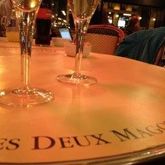 Photo taken at Les Deux Magots by David R. on 4/8/2012
