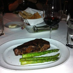 Photo taken at Dominick's Steakhouse by Chris G. on 4/6/2012