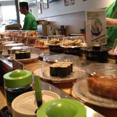 Photo taken at Sushi Train by Luke G. on 5/30/2012