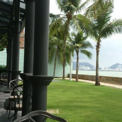 Photo taken at E & O Hotel Beach Area by Ooi T. on 7/14/2012