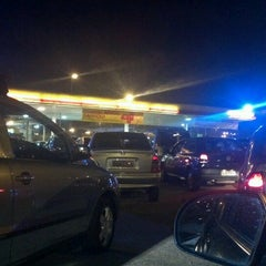 Photo taken at Posto Carrefour (Shell) by Daniela P. on 7/11/2012