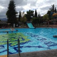 Photo taken at Balneario la Cruz by Pedro R. on 9/1/2012